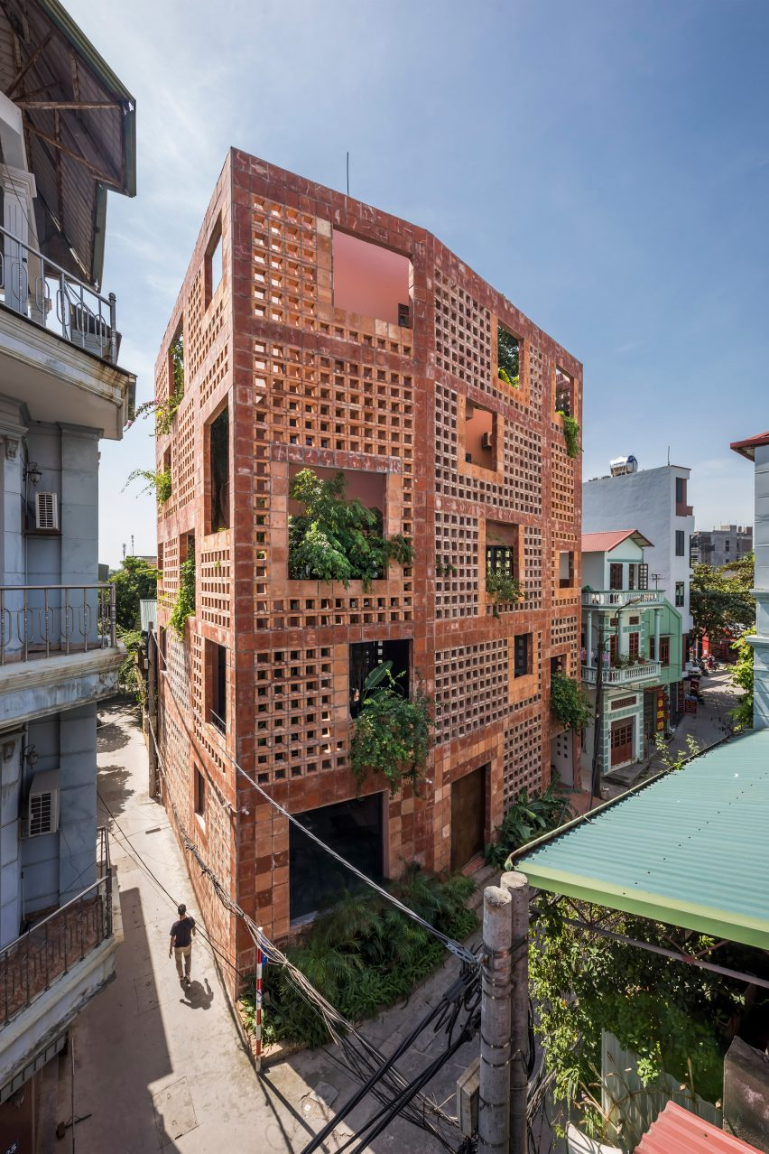 The house has a ceramic brick exterior by Vo Trong Nghia Architects