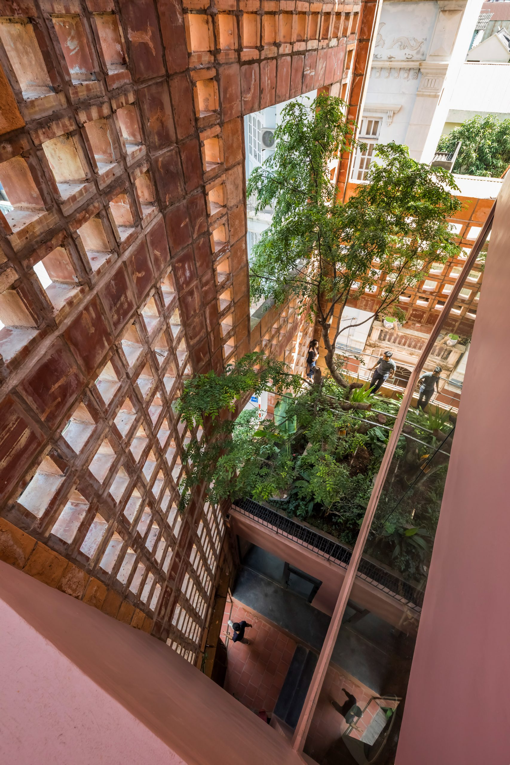 Gardens sit behind the ceramic wall by Vo Trong Nghia Architects