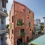 Vo Trong Nghia Architects wraps Bat Trang House in perforated ceramic brick facade