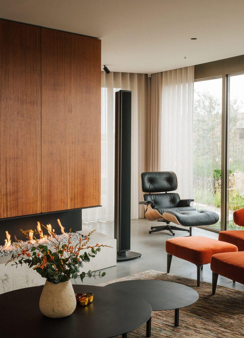 Fireplace in Penthouse BV by Adjo Studio