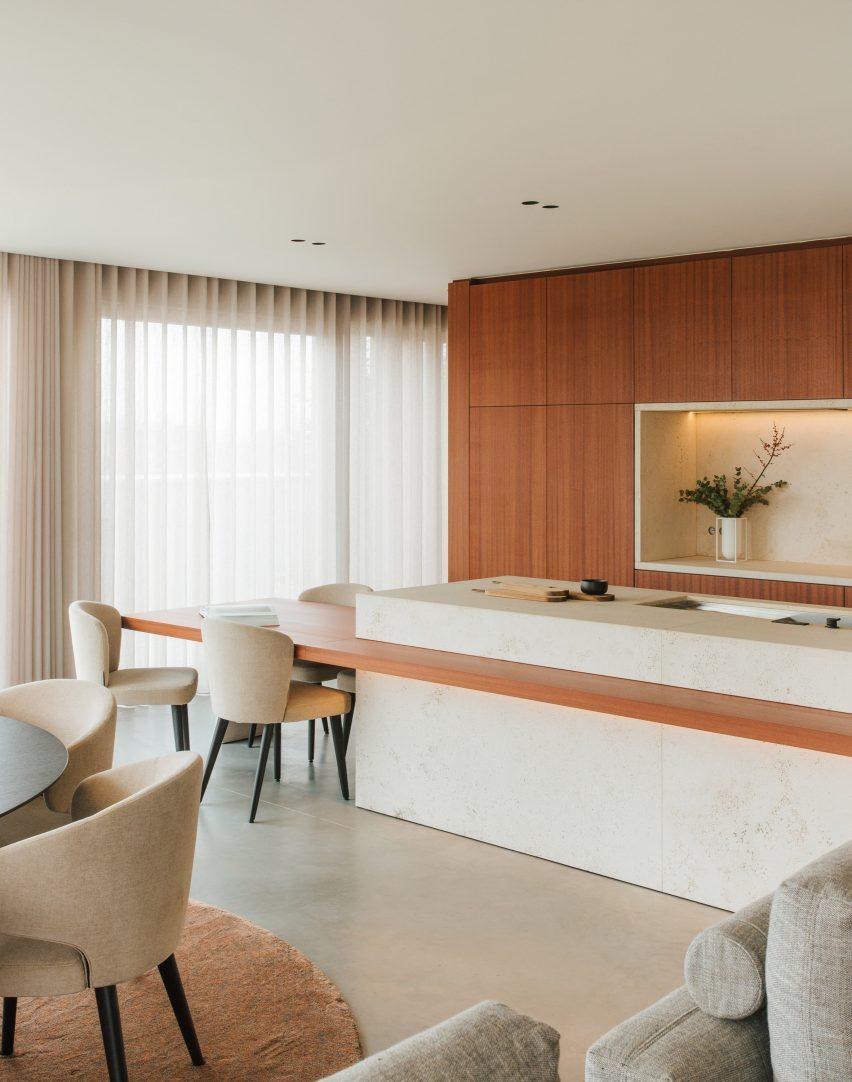 Dining area in Penthouse BV by Adjo Studio