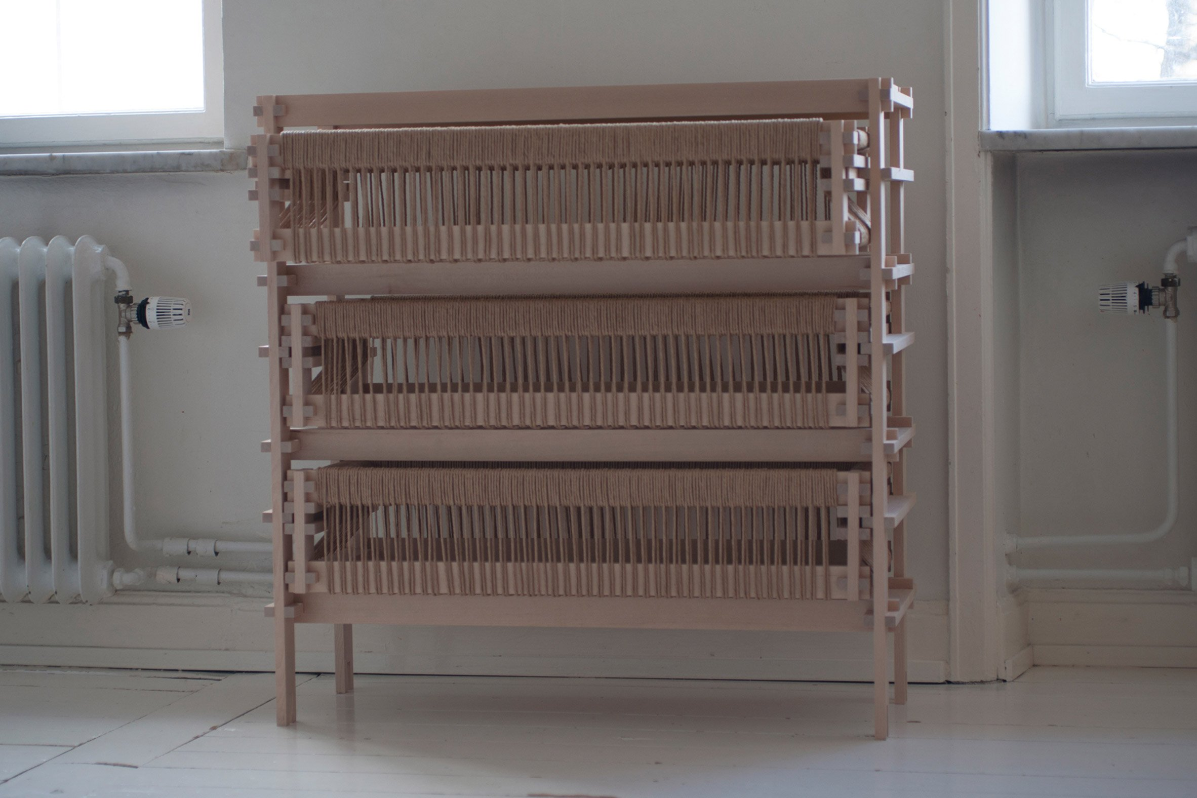 Dresser made from sawmill waste and paper cord