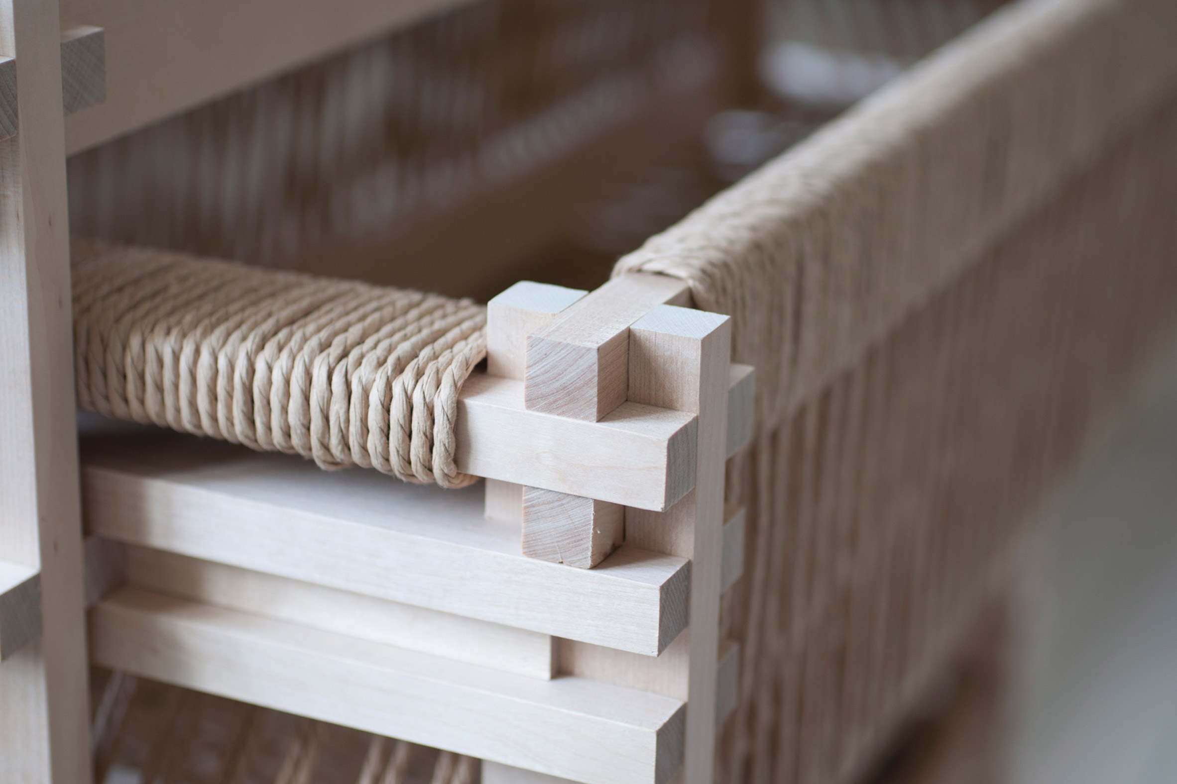 Close-up of dresser made from sawmill waste and wrapped in paper cord