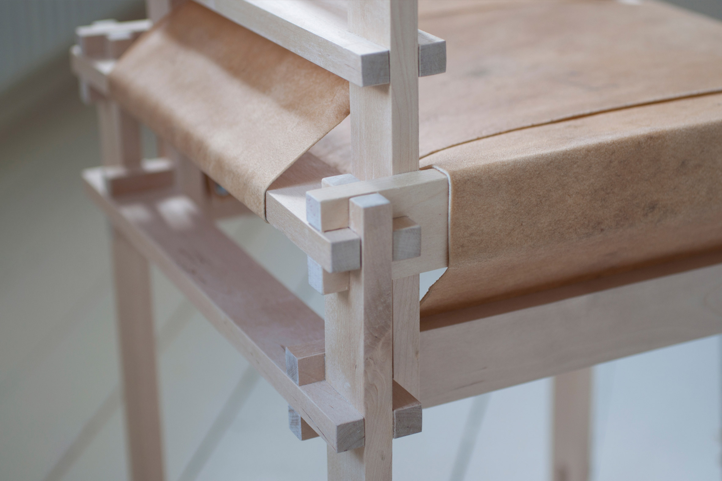 Close-up of wooden chair by Martin Thübeck wrapped in raw cowhide