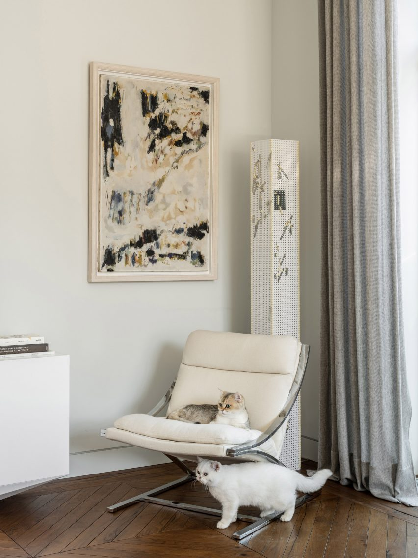 Cats on a Barcelona chair in an interior by Blockstudio