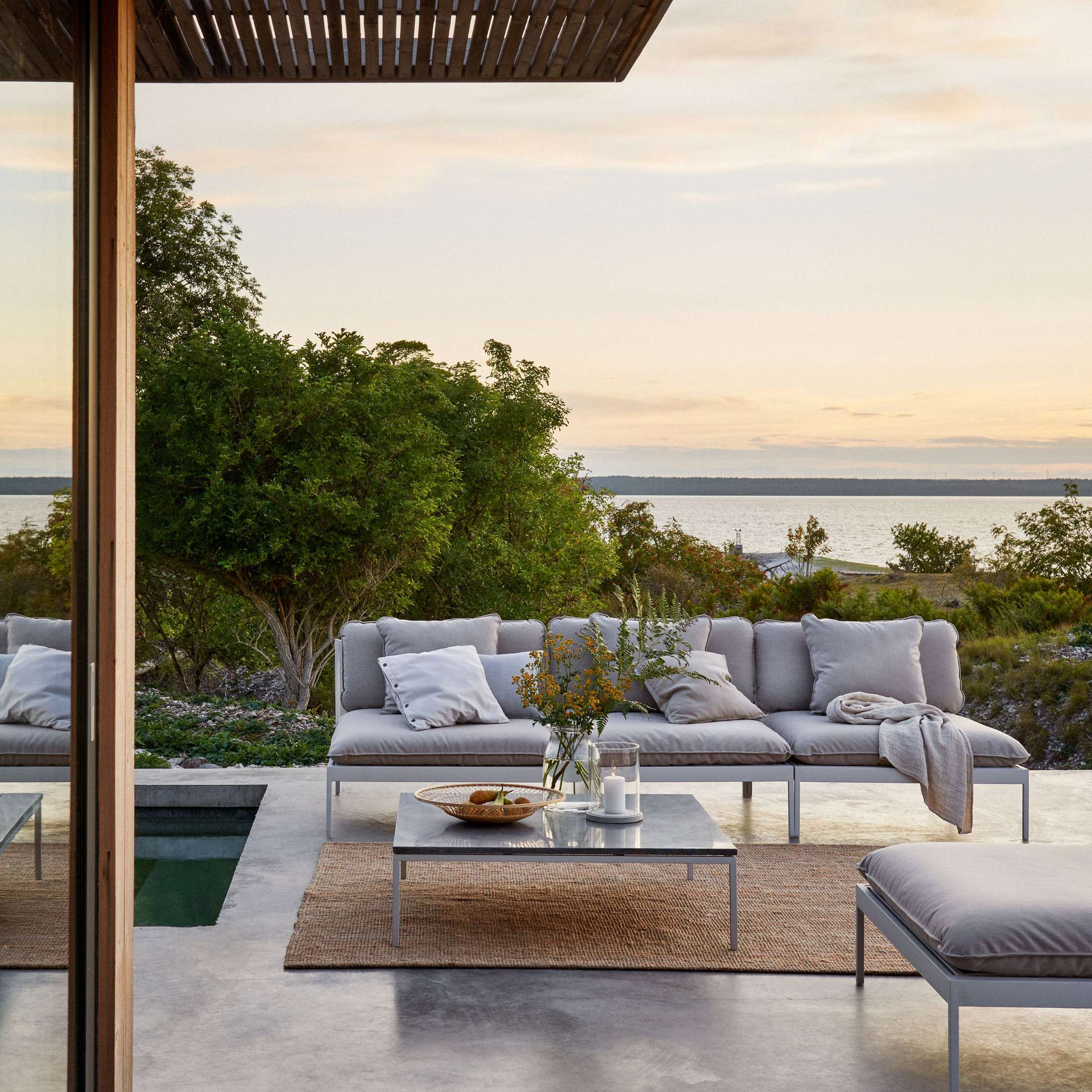 Designed by the founders of Swedish brand Skargaarden for their own home, the Bönan outdoor sofa is made to stay in place year-round