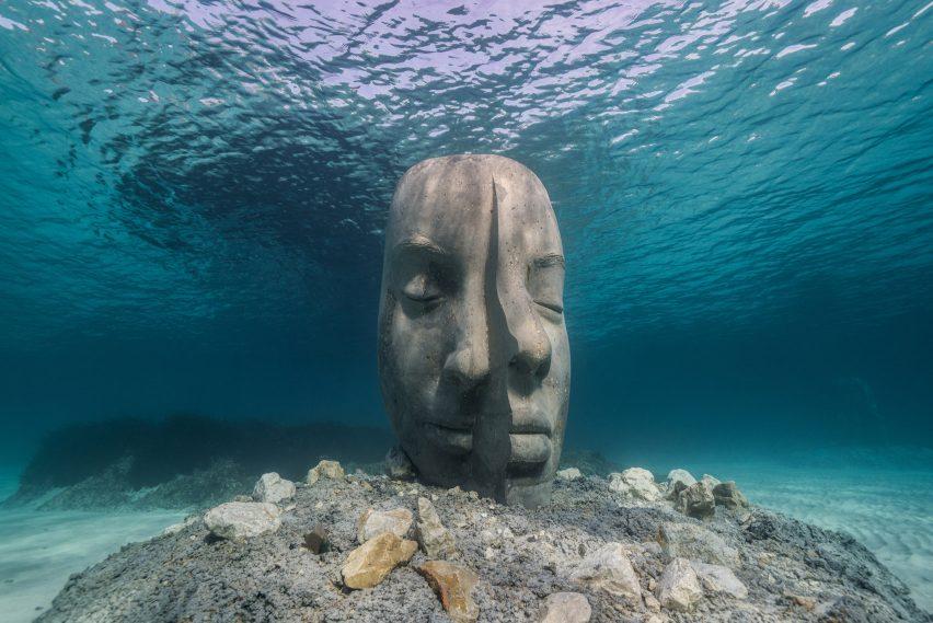 An underwater sculpture of a fragmented human face