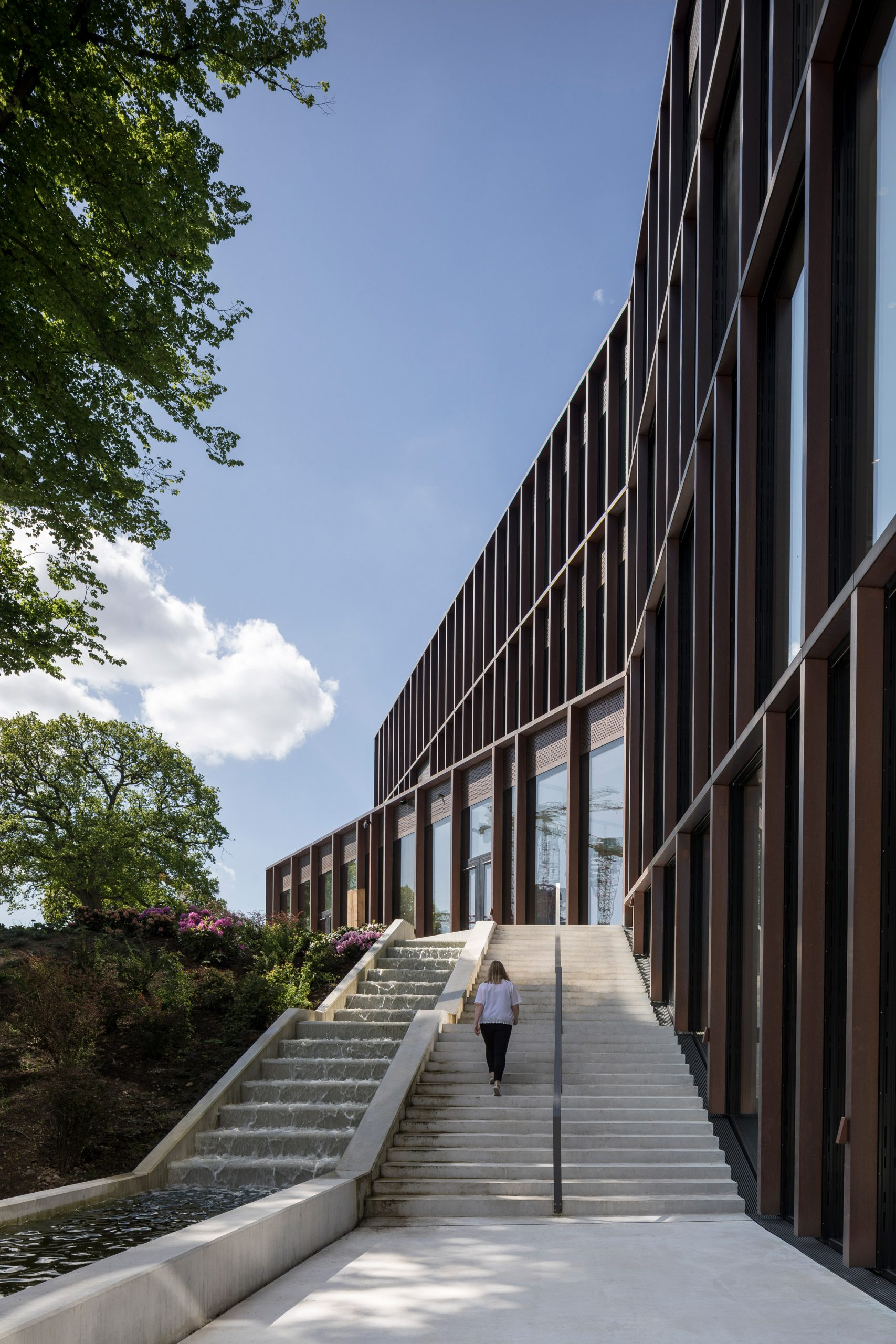 A spring runs the perimeter of the building by CF Møller Architects