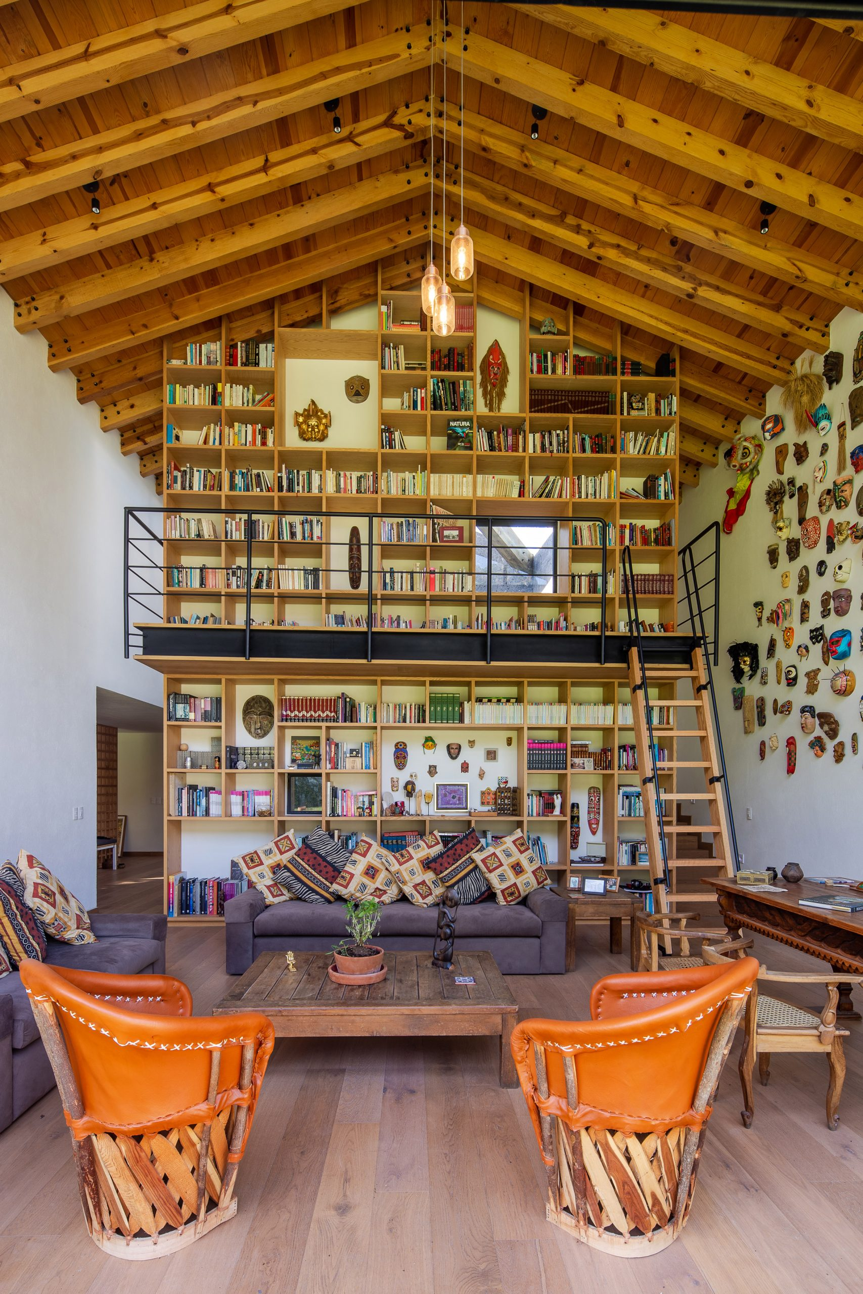 The bookcase also showcases Casa Texcal's mask collection