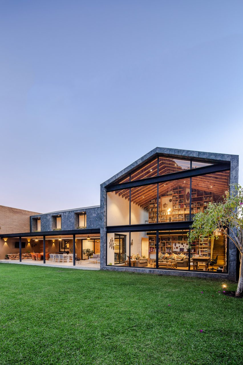 Casa Texcal by HGR Arquitectos has a grassy lawn