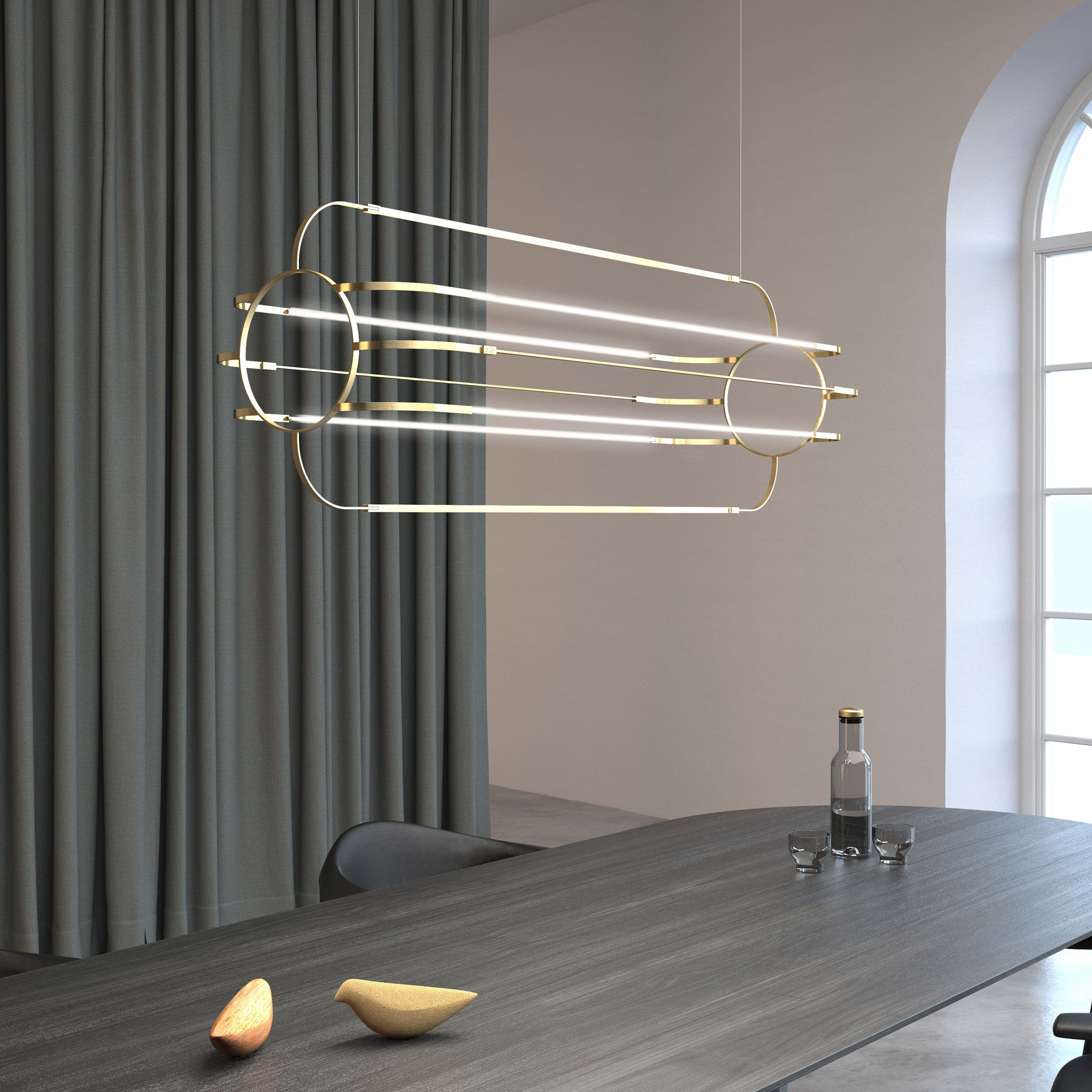 Charlotte pendant light by Daniel Becker Studio above a dining table