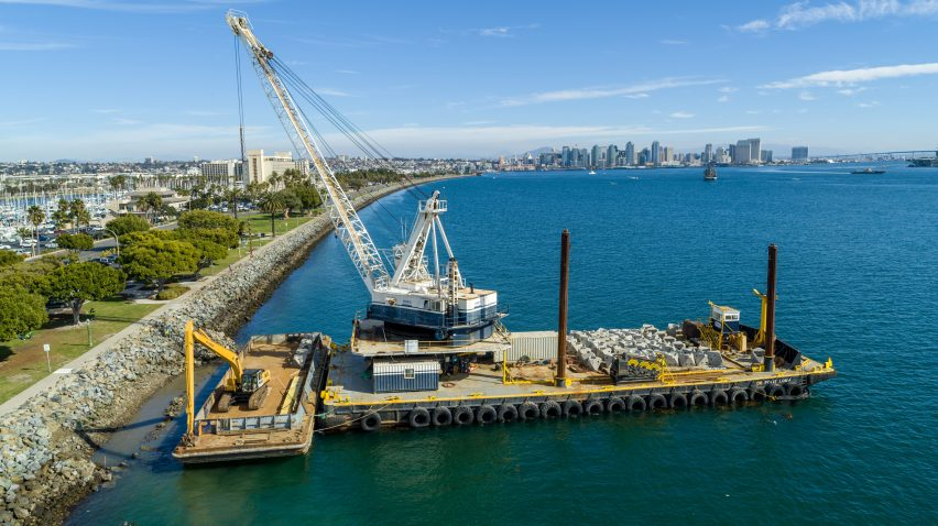 A barge in San Diego Bay carrying man-made rock pools