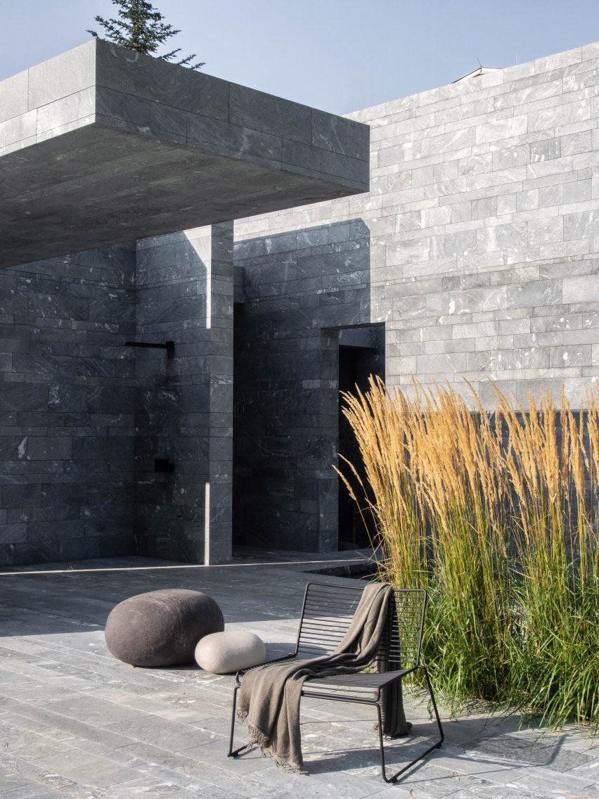 The entrance to a monolithic spa made from blocks of quartzite