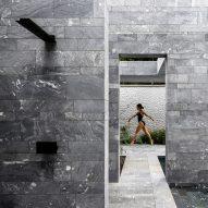 The monolithic stone exterior of a private spa in Austria