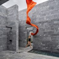 A model outside the stone exterior of a private spa in Austria