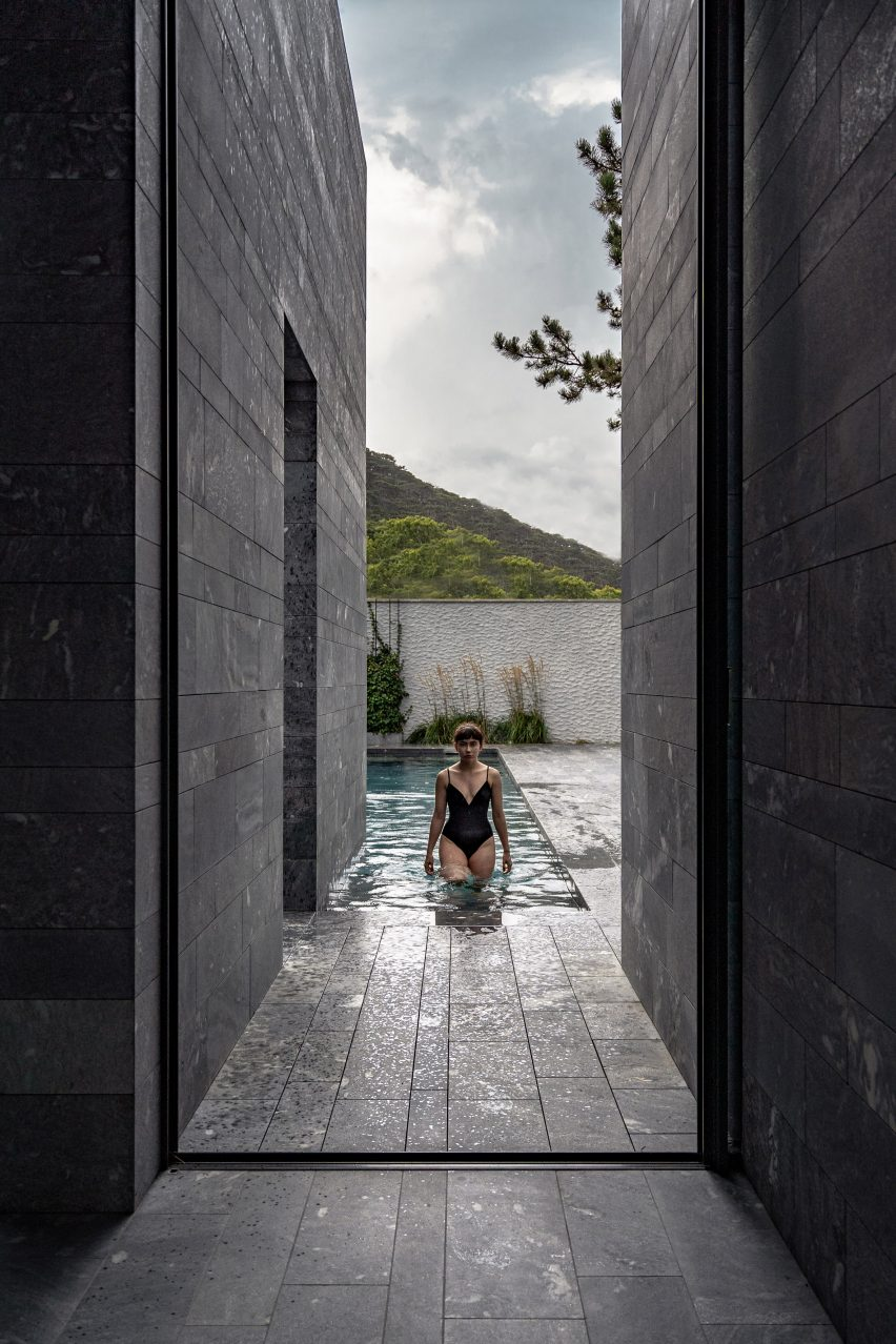 A view to a private swimming pool from a stone spa
