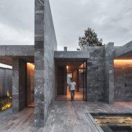 Blocks of stone enclosing a private spa