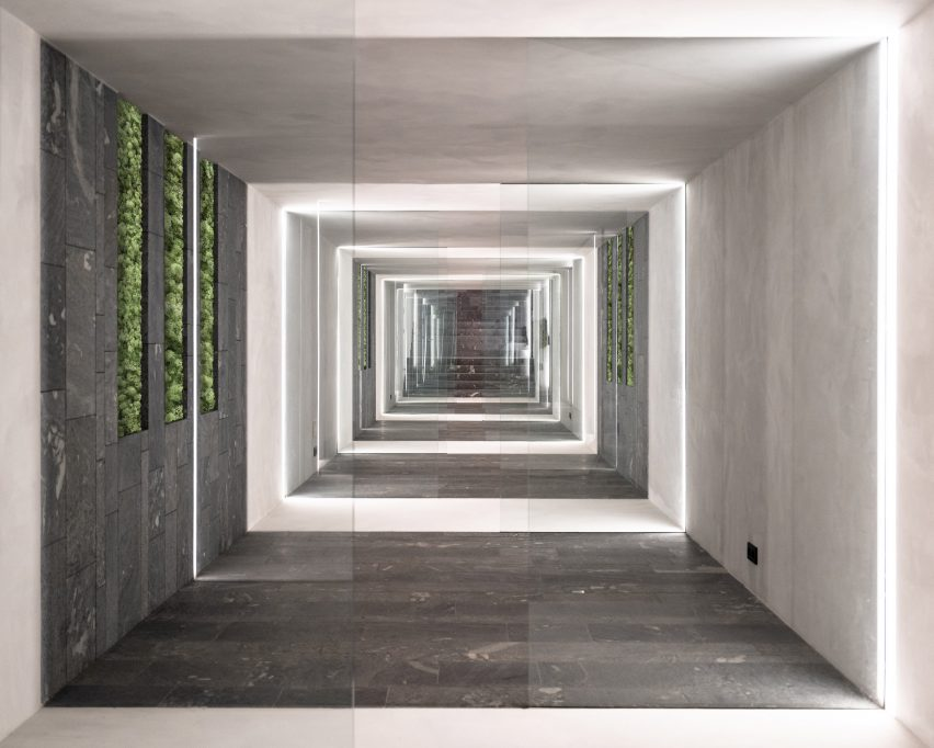 A subterranean corridor lined with stone slabs