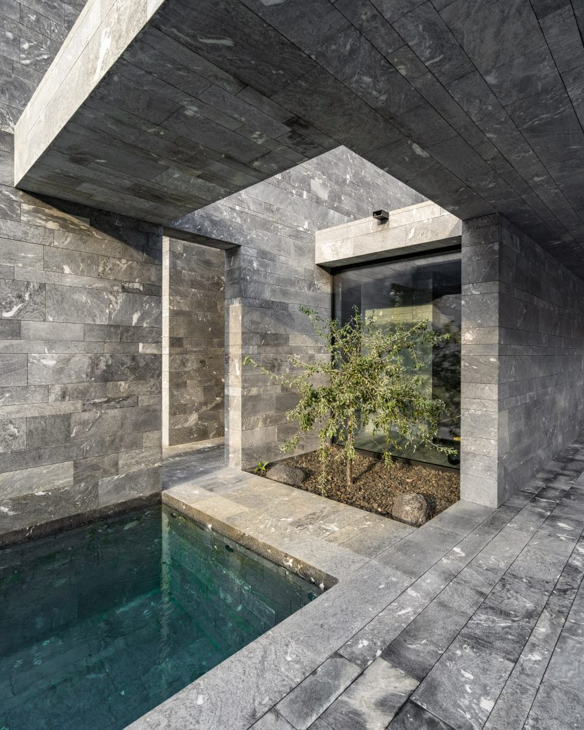 The stone-walled interiors of monolithic private spa