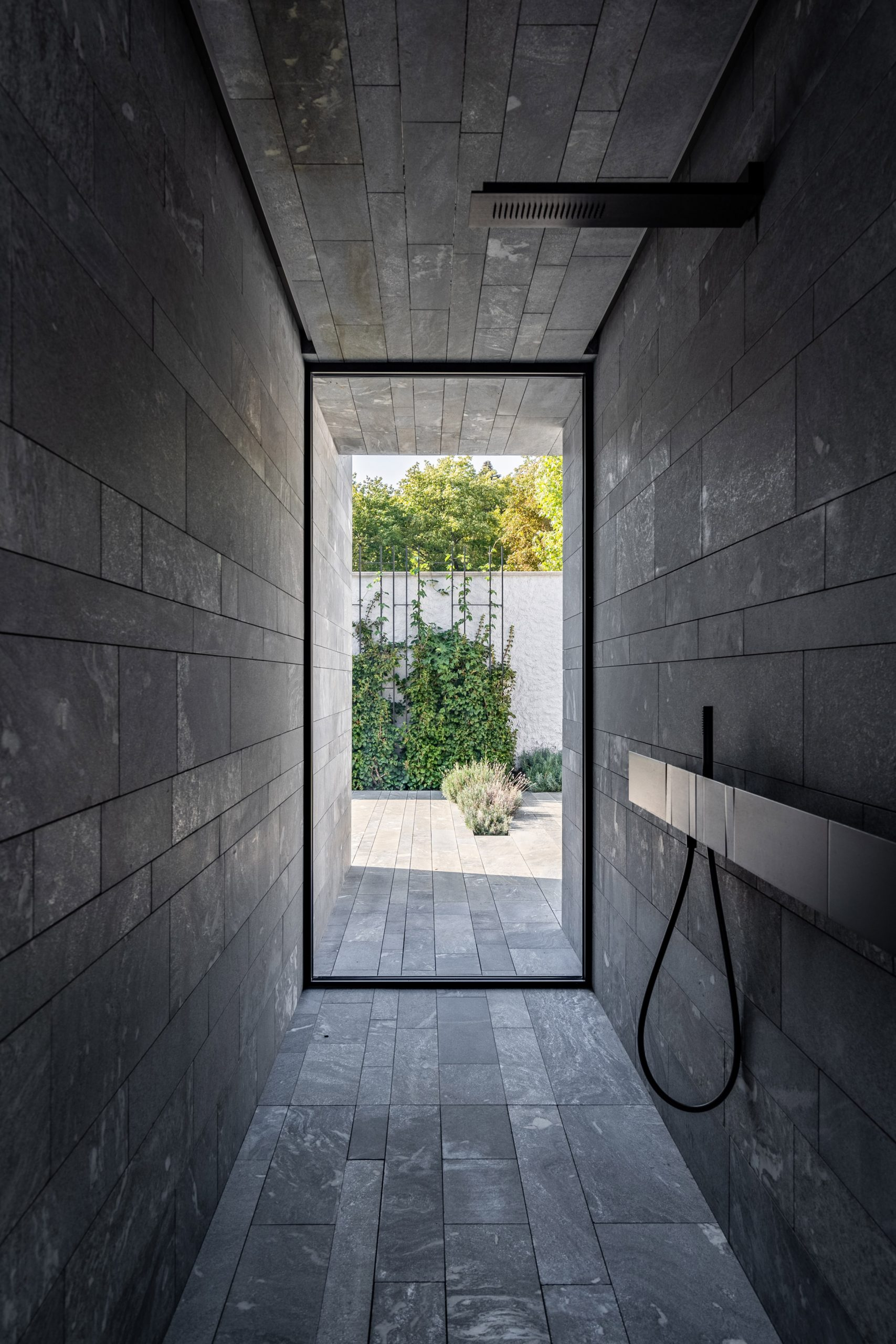 A stone-walled shower room inside a private spa