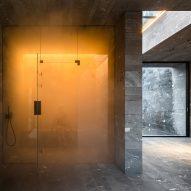 A sauna inside a private stone-walled spa