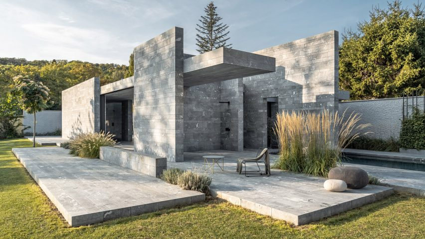A monolithic private spa made from blocks of stone