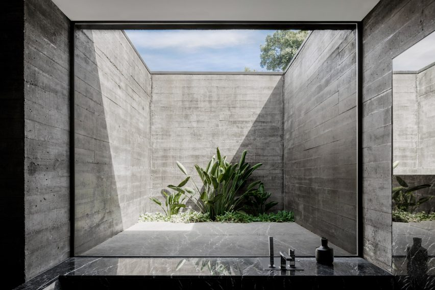 A courtyard enclosed by board-marked concrete