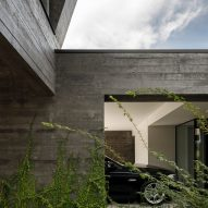 The concrete and glass-walled exterior of Cork Oak House