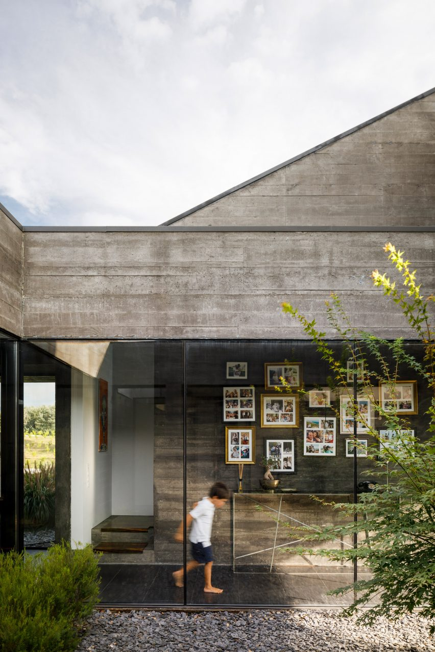 The glass-walled corridor of the Cork Oak House in Portugal