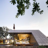 An angular concrete house with a roof terrace