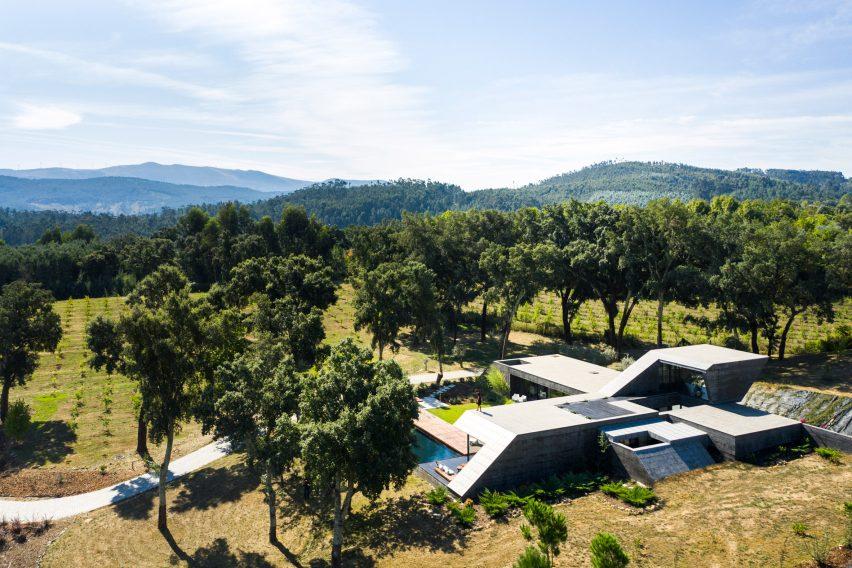 An angular concrete house built on a Portuguese hilltop