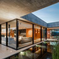 Small pool divides concrete house