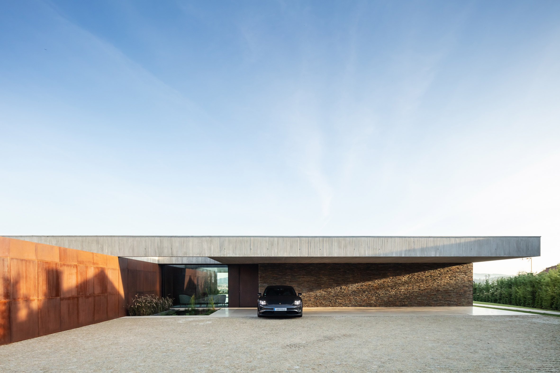Front of concrete and Corten steel house in Braga