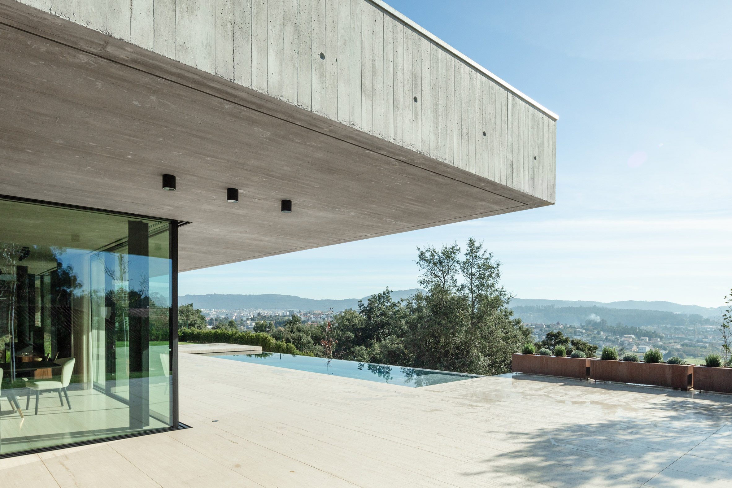 Concrete house with infinity pool