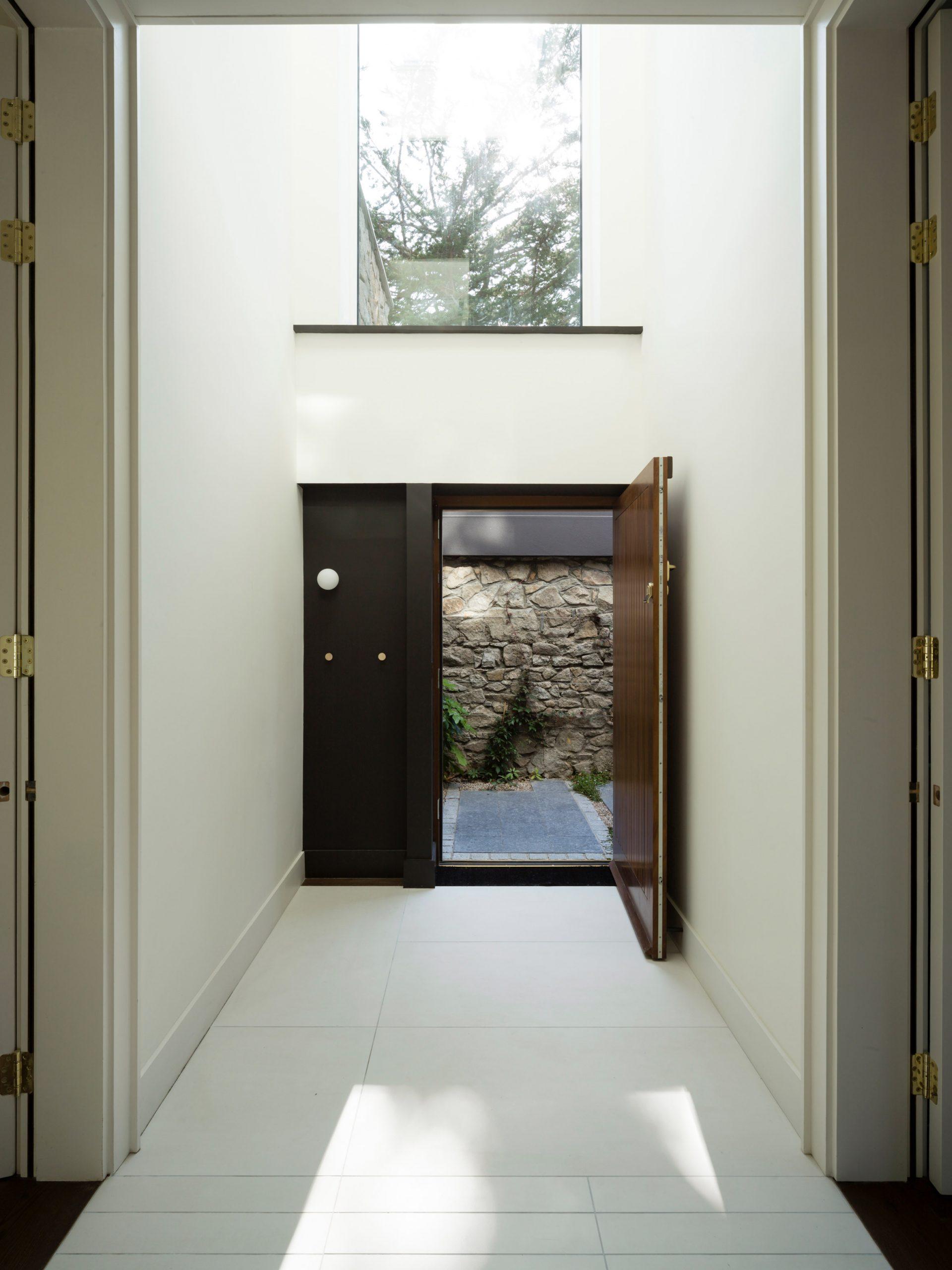 Hallway of Corner House by Studio 304