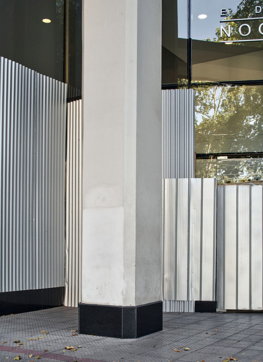 Silver metal covers glass windows and doors