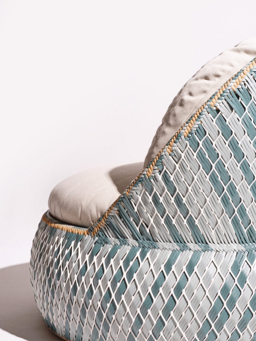 A close-up of a woven chair designed for Dedon