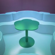 A green table features in one of the renderings