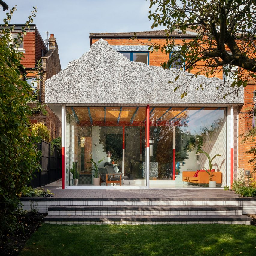 A colourful house extension with a grey mountain-like facade