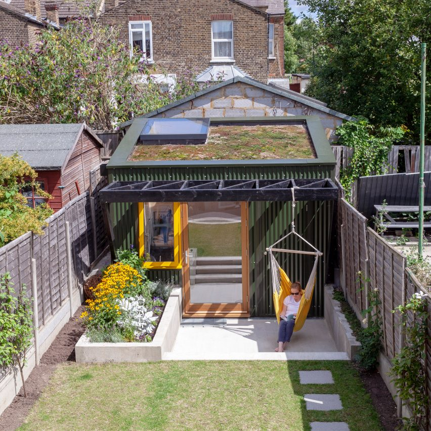 A small garden studio in London with a hammock