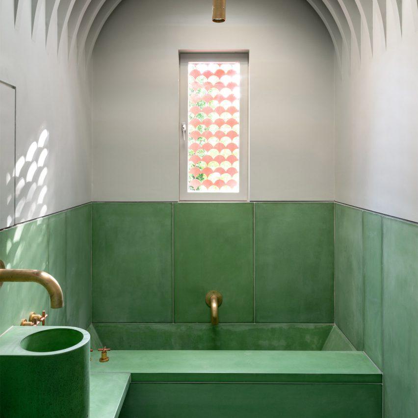A green and white bathroom made from precast concrete