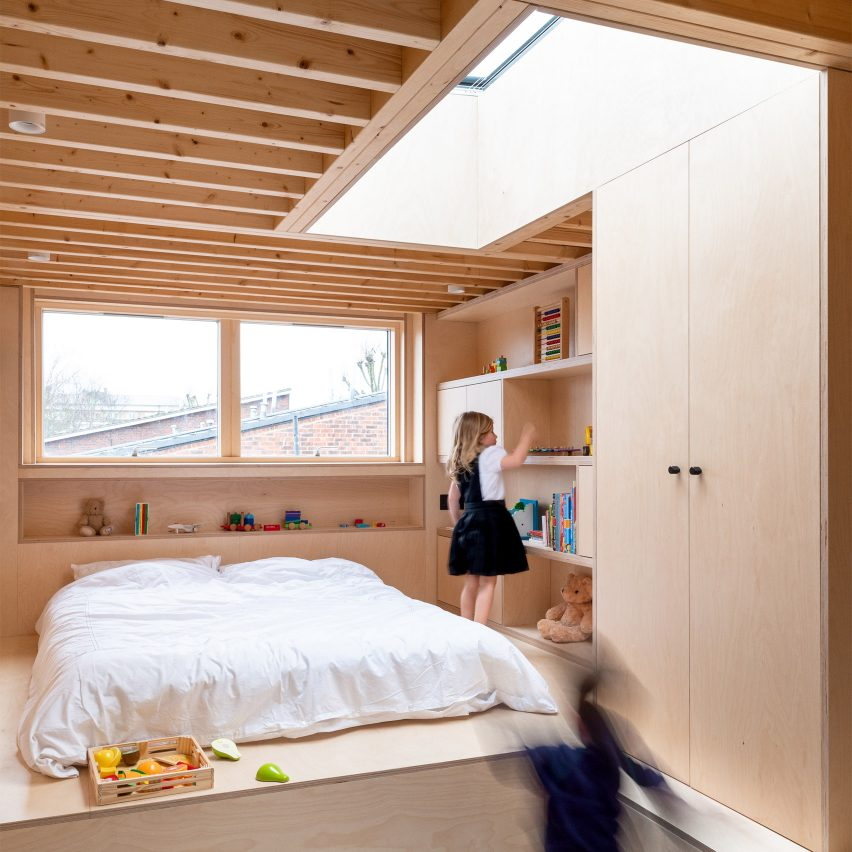 A wood-lined children's bedroom