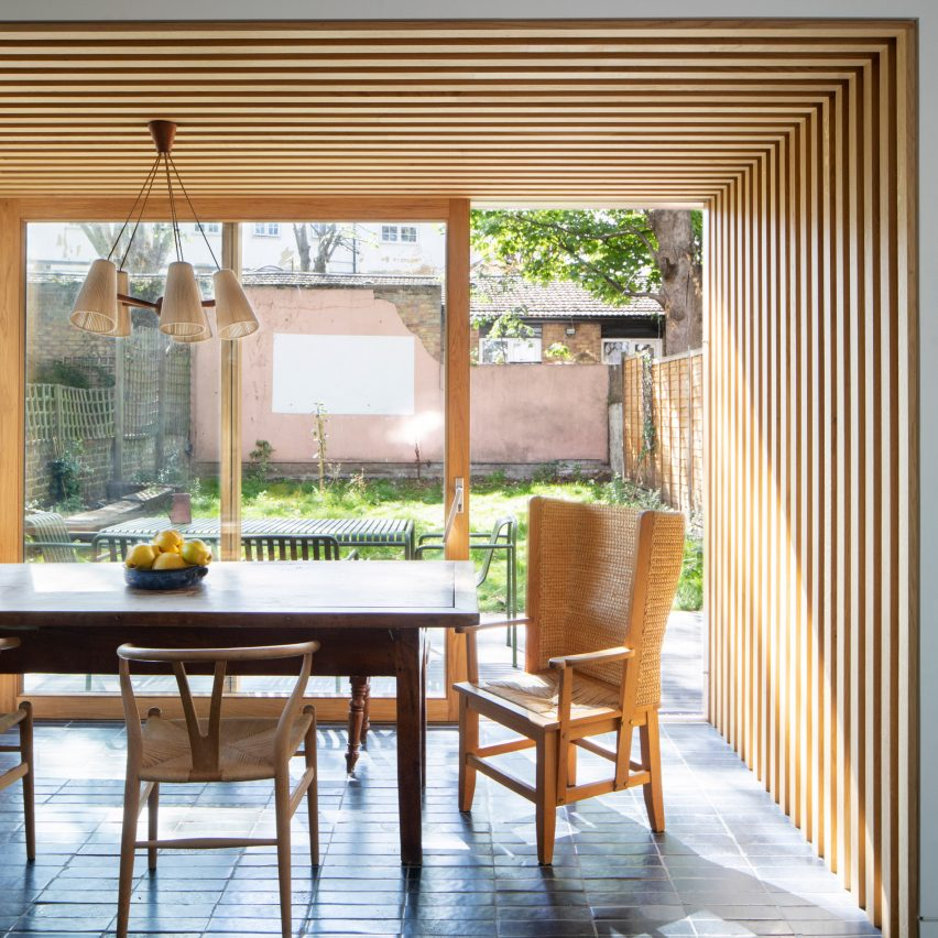 The wood-lined dining room in a townhouse