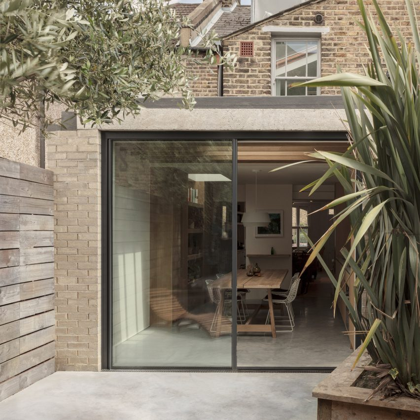 A small light-brick residential extension