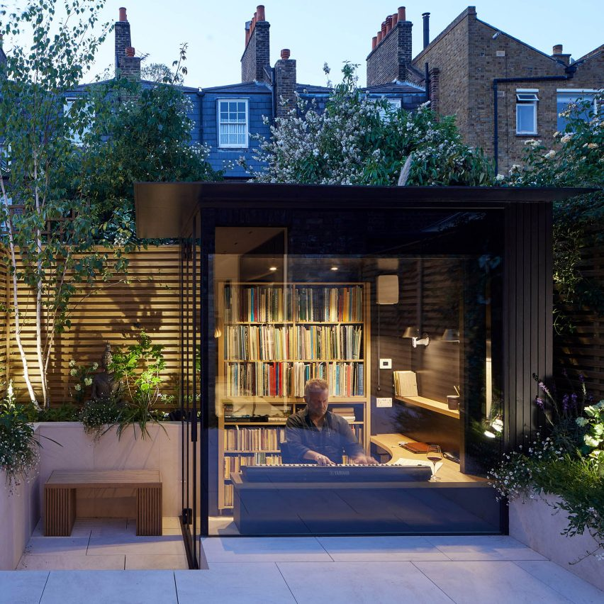 A small glass-lined garden studio