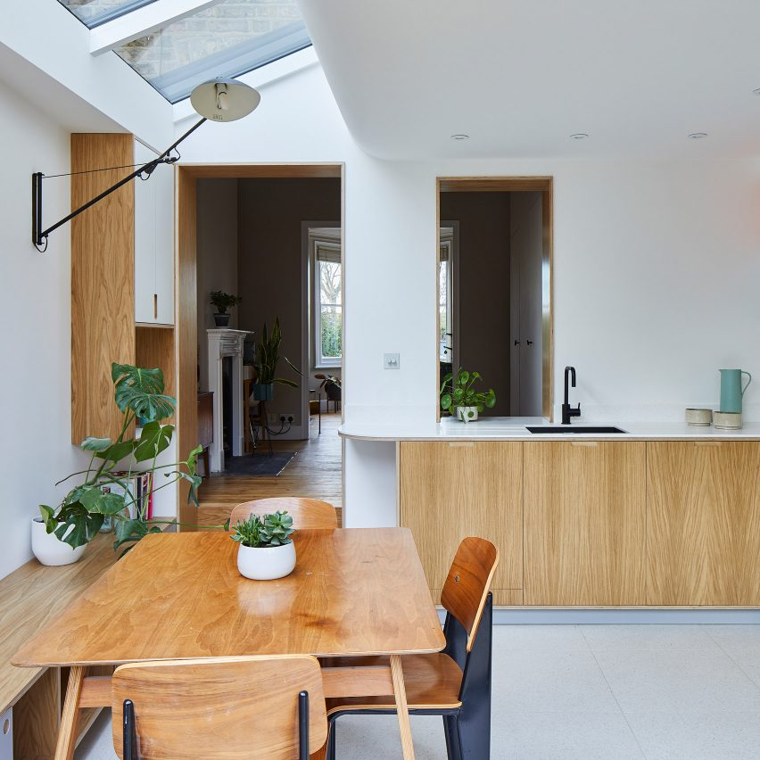 A white-walled kitchen with wooden furnishings