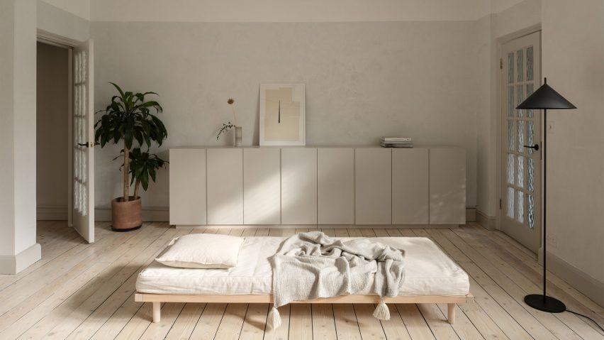 A minimalist bedroom inside a London flat
