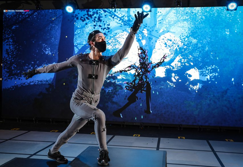 Performer in motion capture suit rehearsing for virtual Dream play