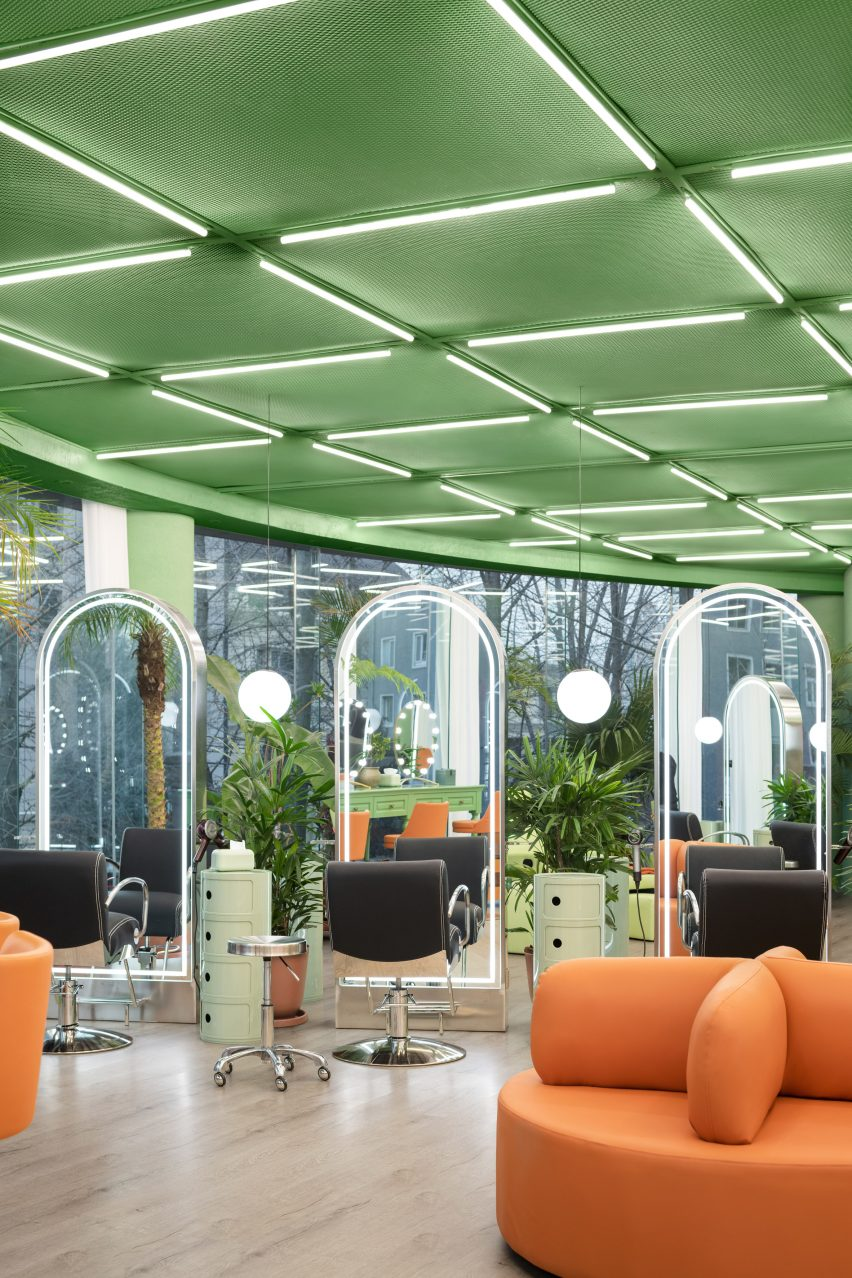 The ceiling is green and has strip lights by IS architecture and design