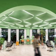 Main salon space with green walls